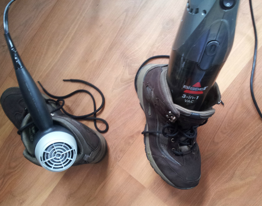 Drying my boots with a vacuum and a hair dryer.